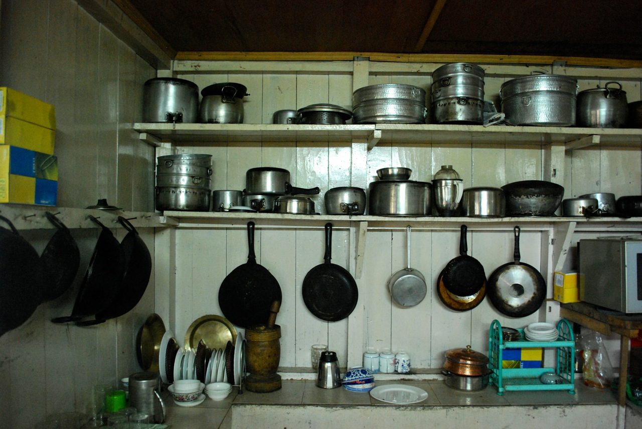 Rows Of Pots Pans And Serving Dishes Line The Walls Shelves Cutlery Room In Kitchen At Farm